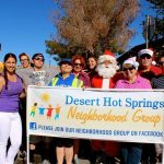 2014, Breanna Sewell with community members at the DHS Holiday Parade — representing TOP Shop and the Desert Hot Springs Neighborhod Group