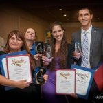 2015, Breanna Sewell with fellow Rotarians showing off all of their awards they received at the 2015 Star Awards in Desert Hot Springs